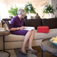 British Prime Minister Theresa May prepares her keynote speech in her hotel room for the Conservative Party Conference at the International Convention Centre in Birmingham on Tuesday. | REUTERS