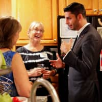 Democratic candidate Ammar Campa-Najjar speaks with constituents during a campaign gathering and fundraising event in El Cajon, California, Sept. 26. | REUTERS