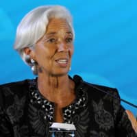 International Monetary Fund Managing Director Christine Lagarde speaks during the closing ceremony for the IMF/World Bank annual meetings in Nusa Dua on the Indonesian resort island of Bali on Sunday. | AFP-JIJI