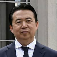 China to expel former Interpol chief Meng Hongwei from advisory body, doesn't say where bribery suspect is being held