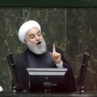 Iranian President Hassan Rouhani speaks during parliament's opening session in Tehran on Saturday. | AP