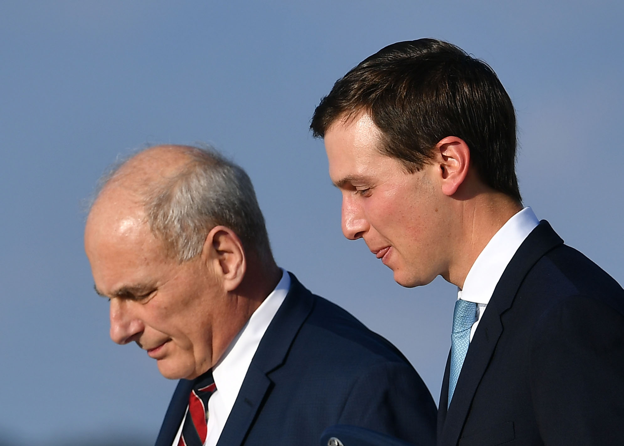 White House senior adviser Jared Kushner (right) and White House chief of staff John Kelly step off Air Force One upon returning to Andrews Air Force Base in Maryland on Oct. 8. | AFP-JIJI