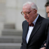 Retired U.S. Supreme Court Justice John Paul Stevens departs the funeral of U.S. Supreme Court Associate Justice Antonin Scalia at the Basilica of the National Shrine of the Immaculate Conception in Washington in 2016.   REUTERS