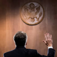 Brett Kavanaugh is sworn in before the U.S. Senate Judiciary Committee on Capitol Hill in Washington on Sept. 27. | REUTERS