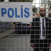 A security guard stands behind barriers blocking the road leading to the Saudi Arabian Consulate in Istanbul on Saturday. | AP