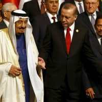 Turkish President Recep Tayyip Erdogan and Saudi King Salman bin Abdul-Aziz al-Saud Salman of Saudi Arabia are pictured during a family photo session at the Organization of Islamic Cooperation summit in Istanbul on April 14, 2016. | REUTERS