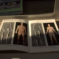 A guidebook shows what North Korea claims are the bones of the mythical King Dangun and his wife, on display in a mausoleum outside Pyongyang. | REUTERS