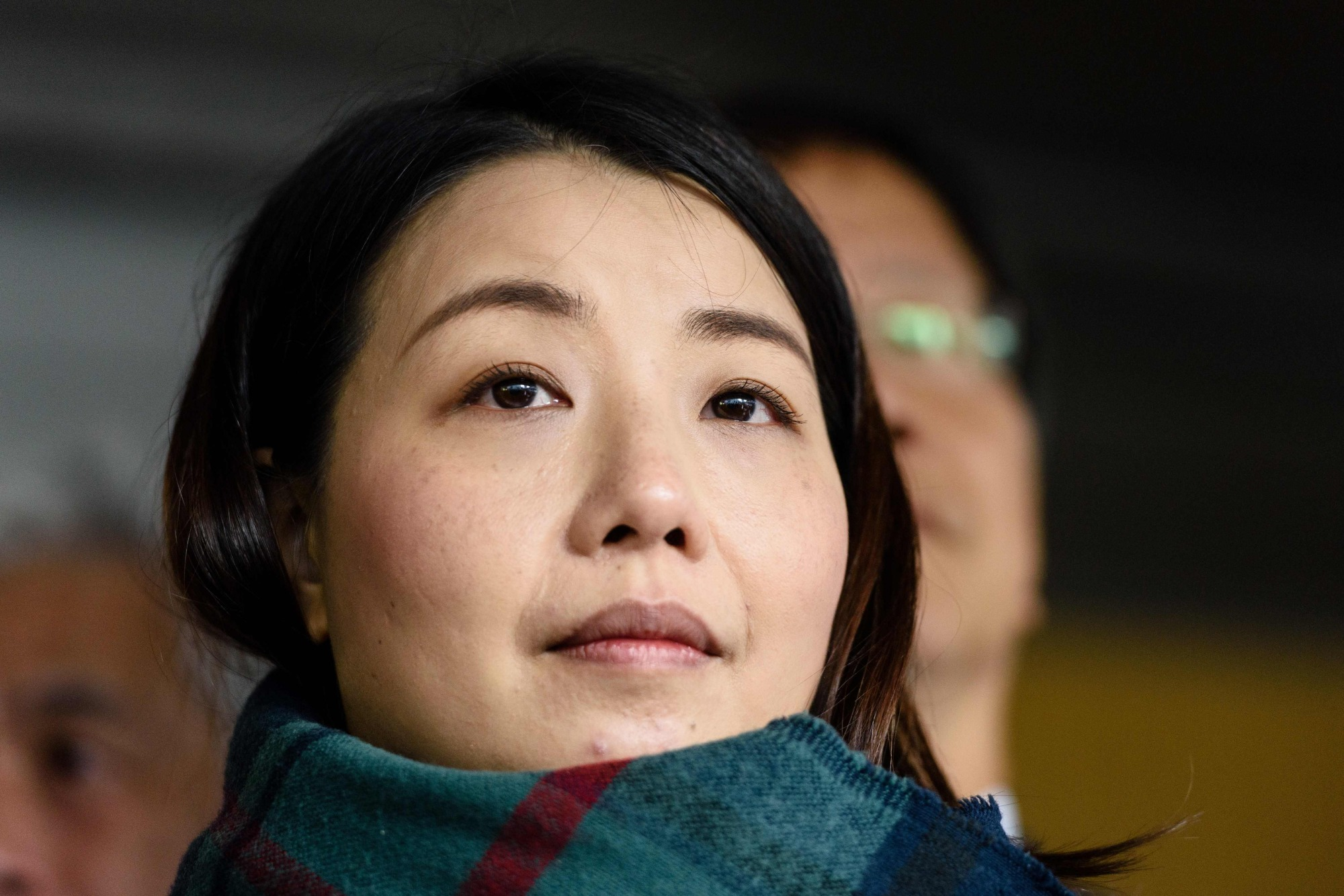 Elected pro-democracy lawmaker Lau Siu-lai stands outside the High Court on March 1, 2017, before facing a judicial review into whether she and three other lawmakers should be disqualified from their Legislative Council seats in Hong Kong. | AFP-JIJI