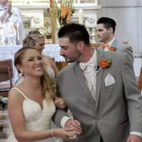 In this June 8, 2018 photo provided by Valerie Lynne Abeling, Erin and Shane McGowan attend their wedding reception in Amsterdam, New York. The couple were among the 20 people who died in Saturday's limousine crash in Schoharie, New York. 'You're always hoping you find the love of your life, it's what you hope and wish and dream for, and they found each other,' Erin McGowan's uncle, Anthony Vertucci, said. 'They had big plans.' | VALERIE LYNNE ABELING / VIA AP