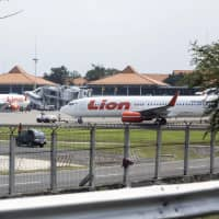 Lion Air aircraft sit on the tarmac at Soekarno-Hatta International Airport in Cengkareng, Jakarta, Indonesia, on Monday. A Boeing Co. 737 Max jet, operated by Indonesia's Lion Air crashed in the Java Sea with 189 people on board, making it the model's first accident and potentially the worst commercial aviation disaster in three years. | BLOOMBERG