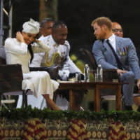 Britain's Prince Harry and Meghan, the Duchess of Sussex, attend an official welcome ceremony at Albert Park as they arrive in Suva, Fiji, on Tuesday. | REUTERS