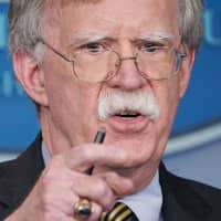 U.S. national security adviser John Bolton speaks during a briefing at the White House in Washington on Oct. 3. | AFP-JIJI