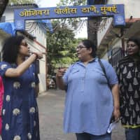 Former TV producer, director and writer Vinta Nanda (third from left) walks with friends outside a police station after filing a complaint against actor Alok Nath in Mumbai on Wednesday. Nanda said on Facebook and in TV interviews that Nath raped her 19 years ago. | AP