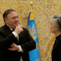 South Korean Foreign Minister Kang Kyung-wha speaks with U.S. Secretary of State Mike Pompeo at the presidential Blue House in Seoul on Sunday. | REUTERS