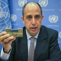 Tomas Ojea Quintana, the United Nations special investigator on human rights in North Korea, holds up a lock given to him by North Koreans who escaped from the country, during a news conference Tuesday at U.N. headquarters in New York. | AP