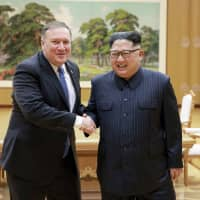 U.S. Secretary of State Mike Pompeo shakes hands with North Korean leader Kim Jong Un during a meeting at Workers' Party of Korea headquarters in Pyongyang in May. | AP