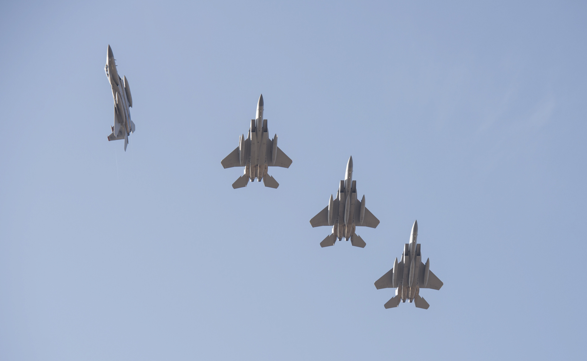 Four U.S. Air Force F-15s from Kadena Air Base in Okinawa Prefecture fly over Gwangju Air Base in South Korea on Dec. 1. The aircraft arrived at Gwangju to participate in the Vigilant Ace joint military exercises. | 18TH WING PUBLIC AFFAIRS