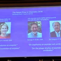 2018 Nobel chemistry laureates Frances H. Arnold of the United States, George P. Smith of the United States and Gregory P. Winter of Britain are displayed on a screen during the announcement at the Royal Swedish Academy of Sciences, in Stockholm on Wednesday. | JONAS EKSTROMER/TT NEWS AGENCY/VIA REUTERS