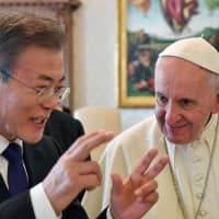 Pope Francis meets South Korean President Moon Jae-in during a private audience at the Vatican Thursday. | ALESSANDRO DI MEO / POOL / VIA REUTERS
