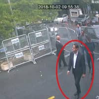 In a frame from surveillance camera footage taken Oct. 2 and published Thursday by the pro-government Turkish newspaper Sabah, a man identified by Turkish officials as Maher Abdulaziz Mutreb, walks toward the Saudi Consulate in Istanbul before writer Jamal Khashoggi disappeared. Saudi Arabia, which initially called the allegations 'baseless,' has not responded to repeated requests for comment from The Associated Press over recent days, including on Thursday over Mutreb's identification. | SABAH / VIA AP