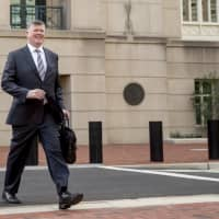 Attorney Kevin Downing departs the federal court following a hearing in the criminal case against former Trump campaign chairman Paul Manafort in Alexandria, Virginia, Friday.   AP