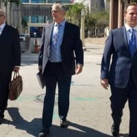 Attorneys (from left) Jamie Benjamin, Daniel Aaronson and Peter Patanzo, representing Cesar Sayoc, who's accused of mailing pipe bombs to prominent critics of U.S. President Donald Trump, walk outside the Federal Court building in Miami Monday. | REUTERS