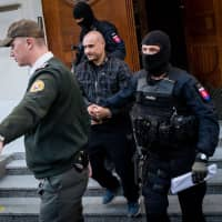 Police escorts Tomas Sz, a suspect charged with premeditated murder of Slovak investigative journalist Jan Kuciak and his fiancee, Martina Kusnirova, after a hearing of Specialised Criminal Court in Banska Bystrica, Slovakia, on Sunday. | AFP-JIJI