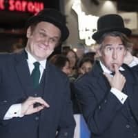 Actors Steve Coogan (right) and John C. Reilly pose for photographers upon arrival at the premiere of the film 'Stan and Ollie' showing as part of the BFI London Film Festival in London Sunday. | VIANNEY LE CAER / INVISION / VIA AP