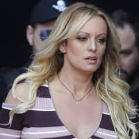 U.S. judge dismisses Stormy Daniels defamation suit against Trump, orders her to pay his legal fees
