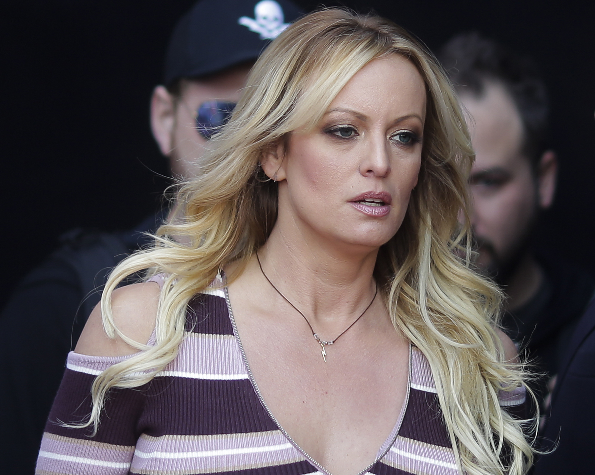 Adult film actress Stormy Daniels arrives for the opening of the adult entertainment fair 'Venus,' in Berlin Oct. 11. On Monday, a federal judge dismissed Daniels' defamation lawsuit against President Donald Trump. | AP