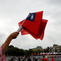 Taiwanese flags are waved during National Day celebrations in Taipei on Oct. 10. | REUTERS