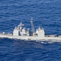 The guided-missile cruiser USS Antietam transits the Philippine Sea during a bilateral training exercise between the U.S. and Japanese forces in March.   U.S. NAVY