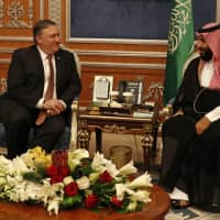U.S. Secretary of State Mike Pompeo meets with the Saudi Crown Prince Mohammed bin Salman in Riyadh Tuesday. Pompeo also met on Tuesday with Saudi King Salman over the disappearance and alleged slaying of Saudi writer Jamal Khashoggi, who vanished two weeks ago during a visit to the Saudi Consulate in Istanbul. | LEAH MILLIS / POOL / VIA AP