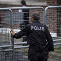A Turkish police officer secures the entrance to Saudi Arabia's consulate in Istanbul Sunday. Veteran Saudi journalist Jamal Khashoggi disappeared over a week ago while on a visit to the Saudi Consulate in Istanbul, sparking an international uproar involving the kingdom, Turkey and the United States that remains unresolved. | AP