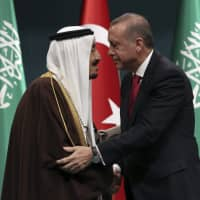 Turkish President Recep Tayyip Erdogan (right) and Saudi Arabia's King Salman embrace each other during a medal ceremony in Ankara in 2016. The disappearance of journalist Jamal Khashoggi from the Saudi Consulate in Istanbul is just the latest crisis to strain relations between the kingdom and Turkey in the wake of the 2011 Arab Spring. | AP