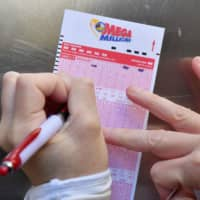 U.S. Mega Millions lottery hits record $1.6 billion after no winning tickets were sold for Friday's draw