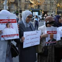 Activists holding portraits reading 'Friends of Khashoggi around the world' attend a protest close to the Saudi Embassy in Paris Thursday. Saudi prosecutors say the killing of journalist Jamal Khashoggi was planned, state-run media reported Thursday, reflecting yet another change in the shifting Saudi Arabian account of what happened to the writer who was killed by Saudi officials in their Istanbul consulate. | AP