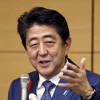 Prime Minister Shinzo Abe makes a speech in Tokyo on Friday. | KYODO