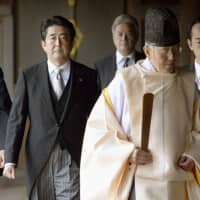 Shinzo Abe visits Yasukuni Shrine in December 2013, his first and so far only visit to the war-linked shrine as prime minister. | KYODO