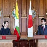 Prime Minister Shinzo Abe and Myanmar's civilian leader Aung San Suu Kyi hold a news conference in Tokyo on Tuesday. | POOL / VIA KYODO