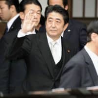 Prime Minister Shinzo Abe after he visited the Yasukuni Shrine in December 2013 in Tokyo. | KYODO