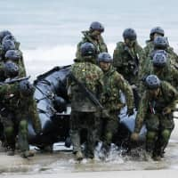 The Ground Self-Defense Force's amphibious troop unit conducts its first joint exercise in Japan with U.S. Marines on Sunday on the island of Tanegashima in  Kagoshima Prefecture, as part of joint training for operations to retake control of an enemy-held remote island. | KYODO