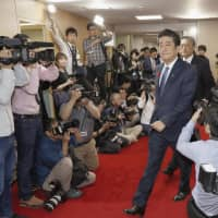 Prioritizing stability, Abe retains key ministers in Cabinet reshuffle while rewarding allies