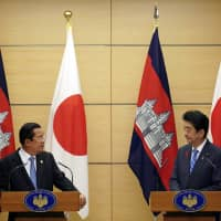 Prime Minister Shinzo Abe and his Cambodian counterpart, Hun Sen, attend a joint press conference at the Prime Minister's Office in Tokyo on Monday. | AP