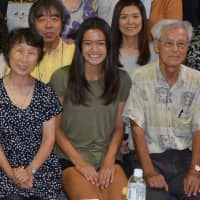 Mieko Hattori (front left) and her husband, Masaichi (front right), pose for a photo with Mia Engelbart (center) during Engelbart's visit to their home in Nagoya in July. | COURTESY OF MIEKO HATTORI