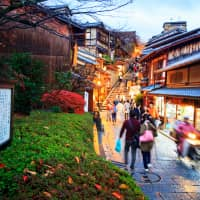 Tourists walk on a street leading to Kiyomizu Temple in Kyoto. The city topped the ranking of major Japanese cities, scoring highly for its historical and cultural assets, as well as its universities. | GETTY IMAGES