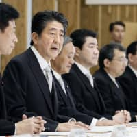 Prime Minister Shinzo Abe speaks at a meeting of senior vice ministers at the Prime Minister's Office on Thursday. | KYODO