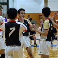 Deaf volleyball team members communicate with each other during a game at an athletic meet on Sept. 23 in Fukaya, Saitama Prefecture. | YOSHIAKI MIURA
