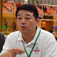 Naoki Kurano, a board member of the Japanese Federation of the Deaf, explains the significance of bringing the Deaflympics to Japan using sign language on Sept. 23 in Fukaya, Saitama Prefecture. | YOSHIAKI MIURA