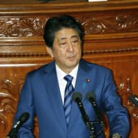 Prime Minister Shinzo Abe addresses the extraordinary Diet session on Wednesday. | KYODO